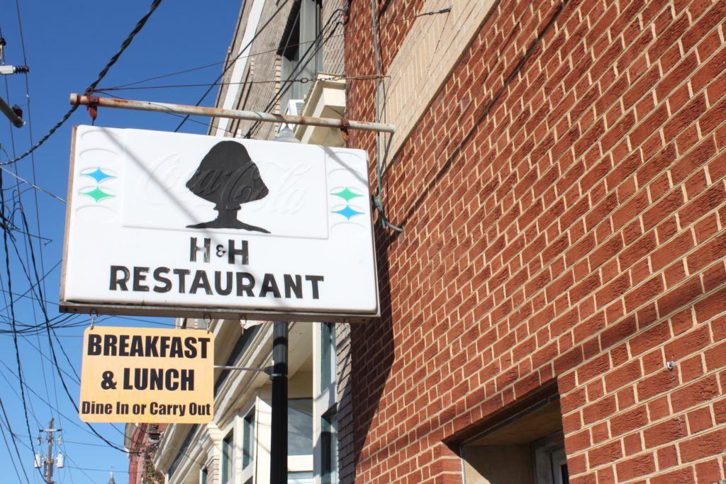 Restaurant sign featuring a mushroom